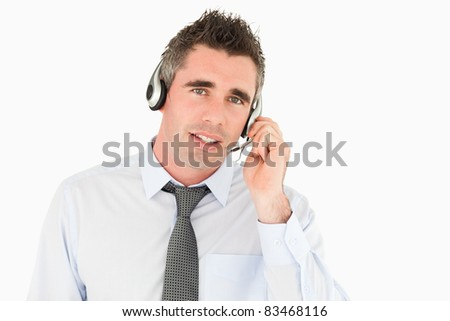 Operator speaking through a headset against a white background