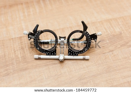 Ophthalmology glasses for measuring diopters with different objects in the background - stock photo