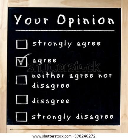 Opinion survey with multiple choices handwritten on blackboard isolated - stock photo
