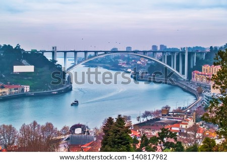 Oporto, December 2012.Arrabida bridge on concrete, Edgar Cardoso 1963, 615 meters over Douro river. - stock photo