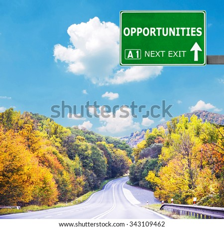 OPPORTUNITIES road sign against clear blue sky - stock photo