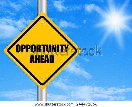Opportunity ahead road sign with blue sky.