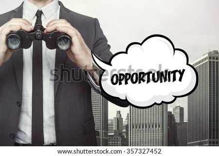 Opportunity text on speech bubble with businessman holding binoculars on city background - stock photo