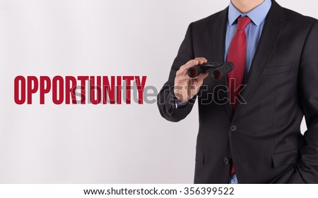 OPPORTUNITY text on white background with businessman holding binoculars - stock photo