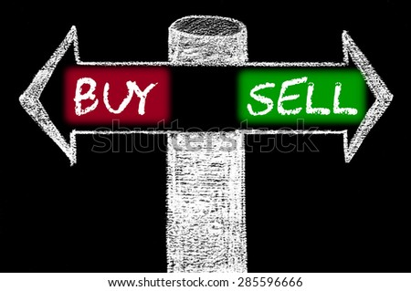 Opposite arrows with Buy versus Sell.Hand drawing with chalk on blackboard. Choice conceptual image - stock photo
