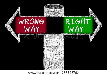 Opposite arrows with Wrong Way versus Right Way.Hand drawing with chalk on blackboard. Choice conceptual image - stock photo
