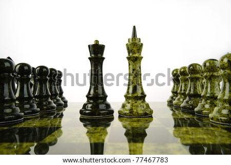 Opposition of chess queen and king - stock photo