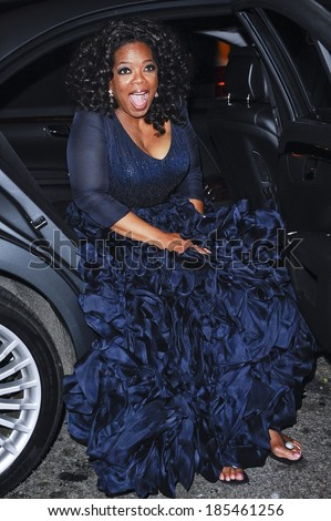 Oprah Winfrey, in navy silk-organza Oscar de la Renta gown, enters The Mark Restaurant by Jean-Georges out and about for CELEBRITY CANDIDS-MONDAY, New York City, New York May 3, 2010 - stock photo