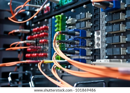Optic cable connected to a single patch panel. - stock photo