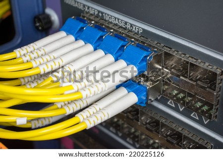 optic fiber cables connected to data center - stock photo