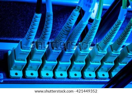 optic fiber hub as part of internet infrastructure - stock photo