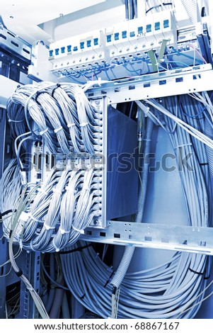 Optical cross-country and telecommunication equipment of network cables in a datacenter - stock photo
