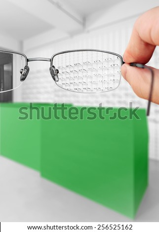 Optical eyeglasses in focus - stock photo