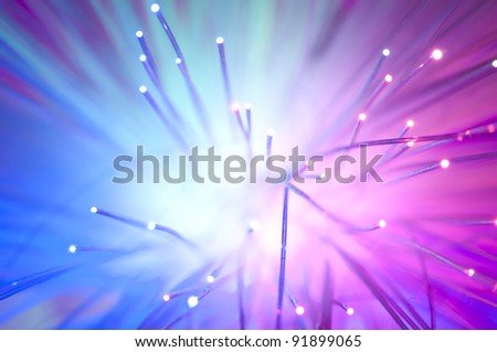 Optical fibers of fiber optic cable. Internet technology.Blue color - stock photo