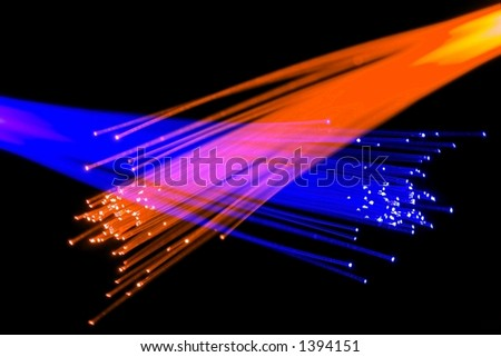Optical fibers over black - concept for speed, technology, communication - stock photo