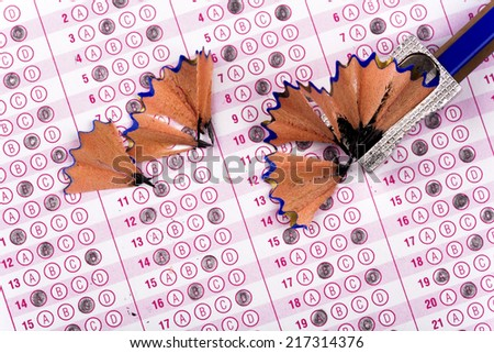 optical form of an examination with pencil and pencil shaving - stock photo