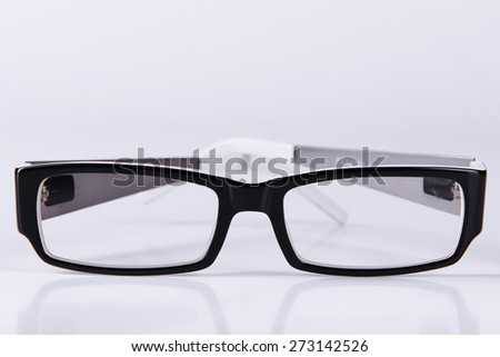 optical glasses on a light gray background closeup