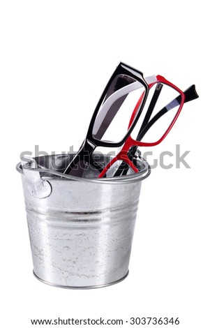 Optical two eyeglasses thrown in a bucket isolated on a white background - stock photo