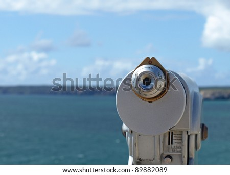 Optical viewfinder looking at the sea and cliffs at Cabo de Sagres, Portugal - stock photo