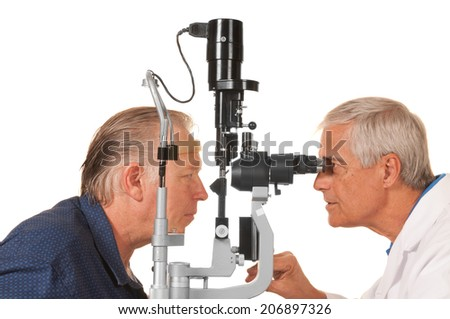 Optician, Optometrist or Ophthalmologist checking patient's eyes, isolated on white - stock photo