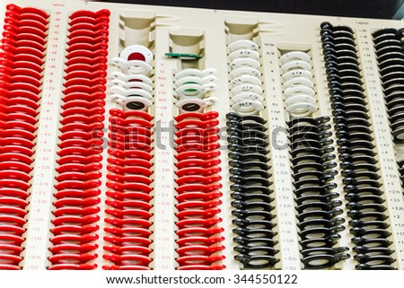 Optician's work place showing the full range of all the lenses and fittings an optician uses to determine a patients correct prescription.  - stock photo