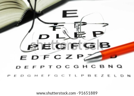 optician with eye test and book - stock photo