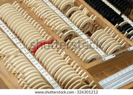Optician with set of trial frames and trial lenses - stock photo