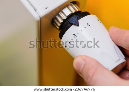 Optimal setting of the thermostat valve. Radiator adjustment to save energy. Save energy and money concept - stock photo