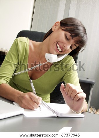 Optimist hispanic businesswoman working at office. - stock photo
