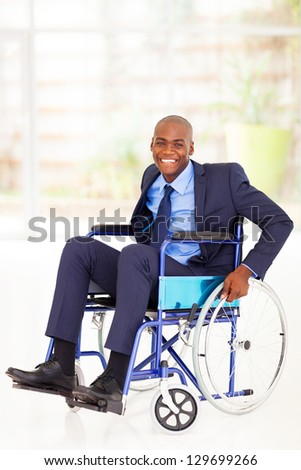 optimistic disabled african american businessman sitting on wheelchair - stock photo