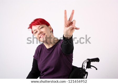Optimistic Girl in wheelchair - stock photo