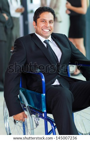 optimistic handicapped businessman in a wheelchair - stock photo