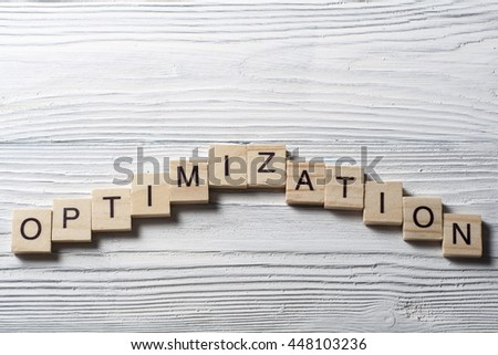 Optimization word written on wood block. Wooden abc blocks