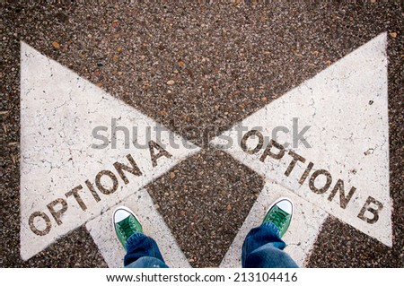 Options a and b dilemma concept with man legs from above standing on signs - stock photo