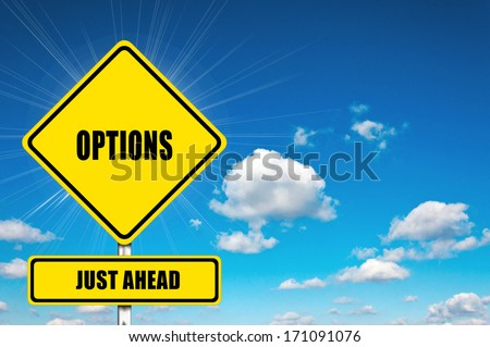 Options yellow road sign with clouds and sky in background  - stock photo