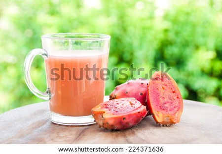 Opuntia fruit on and juice - stock photo