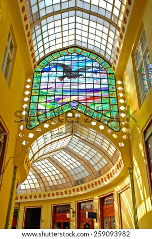 ORADEA - OCTOBER 12: The Black Eagle Palace equipped with a glass covered passage is one the major tourist destination of the city. On October 12, 2005, in Oradea, Romania - stock photo