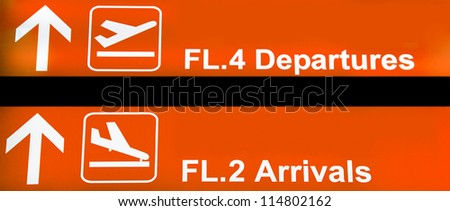 Orange airport sign with arrivals and departures - stock photo