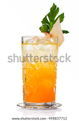 Orange alcohol cocktail with green garnish isolated on white