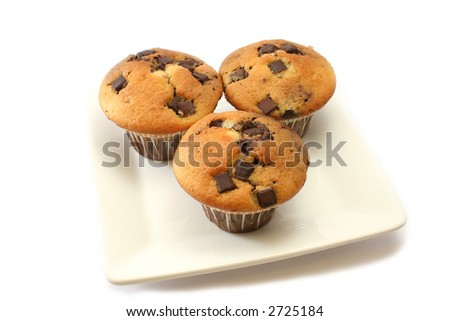 Orange and chocolate flavoured muffins with choc chip pieces - stock photo