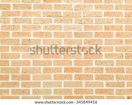 orange and cream color of brick stone cement wallpaper background texture:copyspace modern brickwork concrete wall backdrop:clean/rough of bricklayer stucco wall interior inside room ornament concept - stock photo
