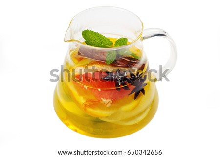 Orange and grapefruit drink with a spices in a glass decanter
