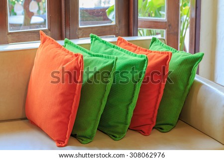 orange and green colorful pillows interior cafe