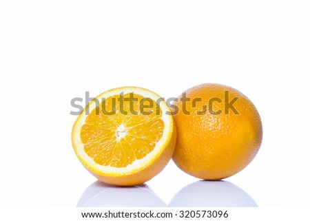 Orange and half orange on  white background - stock photo