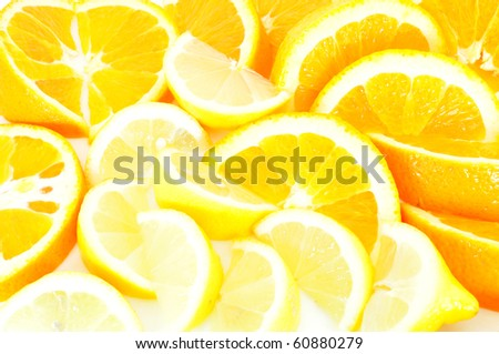 orange and lemon slices scattered as a background - stock photo