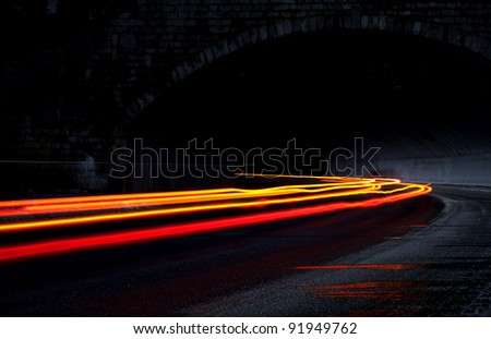 Orange and red lights in a tunnel - stock photo