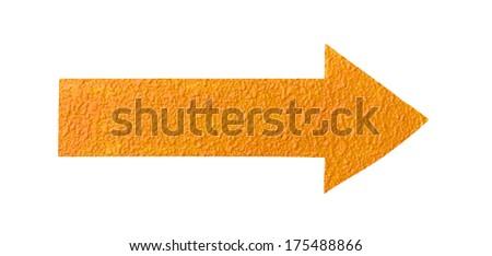 orange arrow on white rough concrete wall  - stock photo