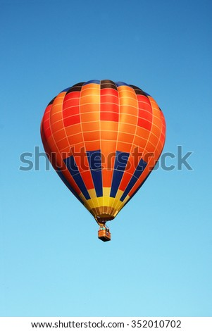 Orange balloon on blue sky