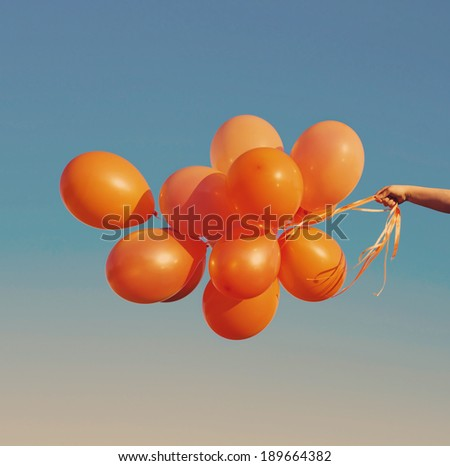 orange balloons on blue sky - stock photo