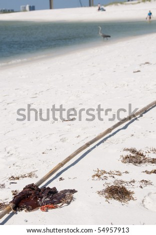 ORANGE BEACH, AL - JUNE 10: A large sticky rag of oil washes ashore at Perdido Pass, AL on June 10, 2010 as the BP oil spill washes ashore. - stock photo